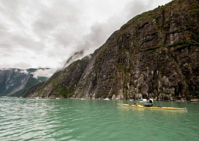 tracy arm yellow kayak cliffs